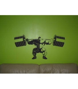 Athletic man start lifting a bareballs wall sticker.