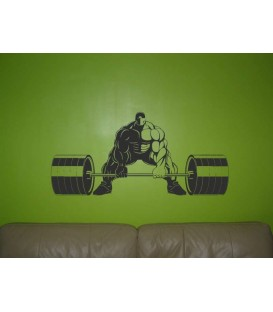 Athletic man gets ready to lift a barbells wall sticker.