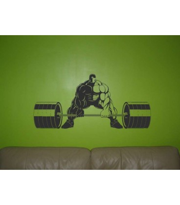 Athletic man gets ready to lift a bare balls wall sticker.